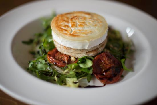 Herefordshire, UK: Glazed goats cheese on croute with slow roasted tomato & rocket salad