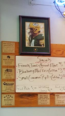 CORRAL BAR AND RIVERSIDE GRILL: specials menu and Brett Favre