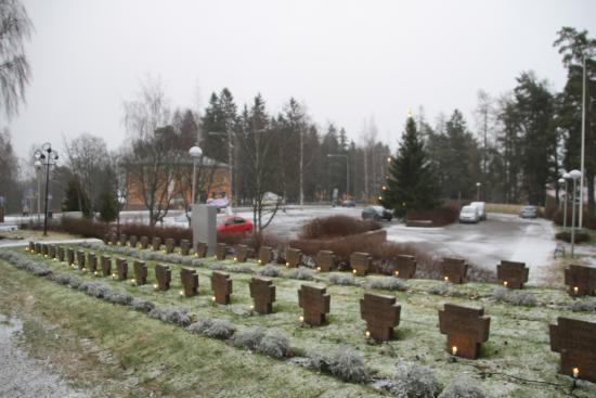 Palkane, Finland: Candles lit for respect of the fallen