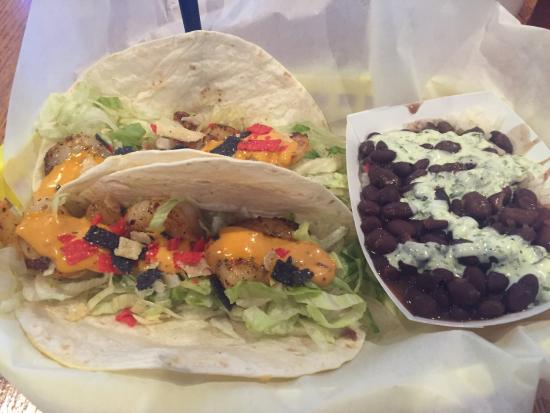 TJ's Seafood Shack: First time there and it was great.  The shrimp tacos with black beans and their special sauce wa