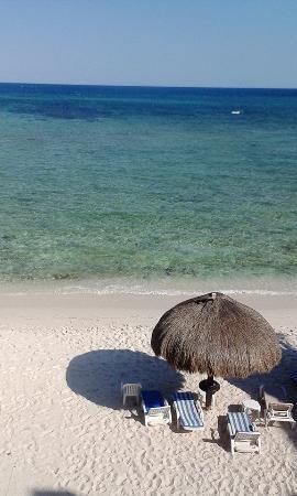 view down to palapa on beach in front of Hacienda De La Tortuga.