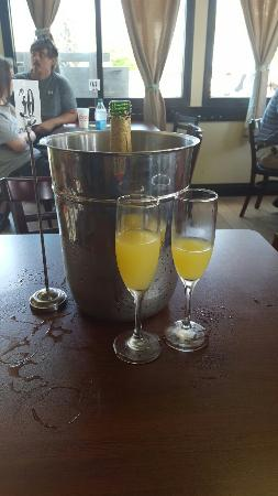 Liza's Kitchen: Bucket of mimosas . Just adds to the wonderful food !