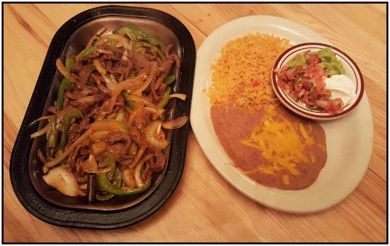 Dundee, Oregon: Sizzling steak fajitas with beans and rice.