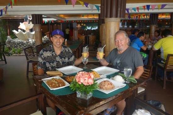 Dakak Park & Beach Resort: My son and I getting ready to enjoy a great meal