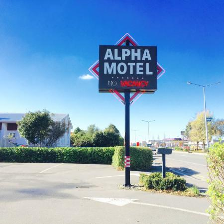 Alpha Motel Luxury Apartments: sign