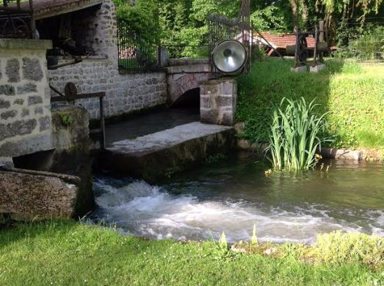 Moulin des Chennevieres : Water from water wheel under mill house