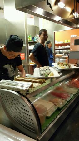 Somerset, Pensylwania: Men at work. I love restaurant where you can catch a glimpse of your food being prepared