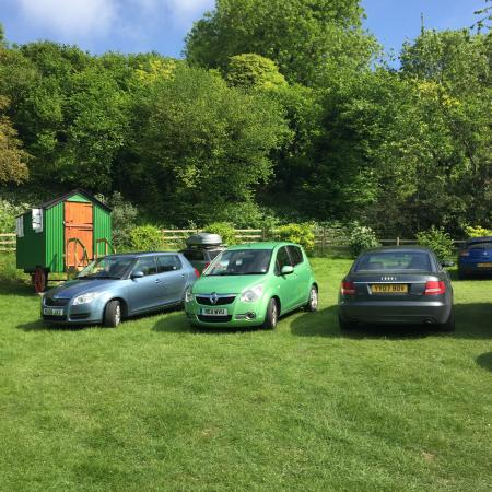 Britchcombe Farm: The car park and check in area. Which also doubles as the camp sites for electric hookups. So be