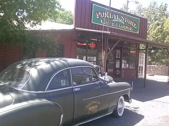 Portal cafe and antique car,