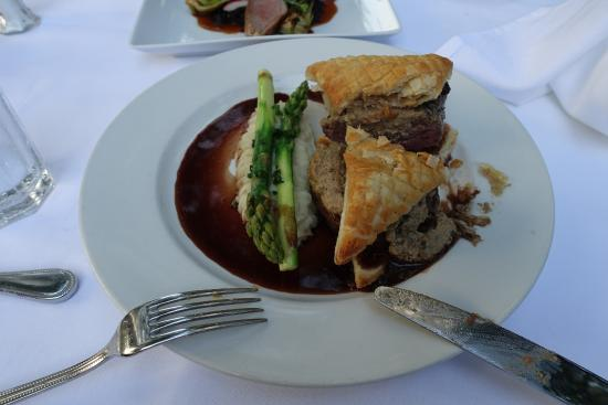 Fig Tree Restaurant: Beef wellington cut to check if cooked correctly. Waiter asks that you check if its done correct