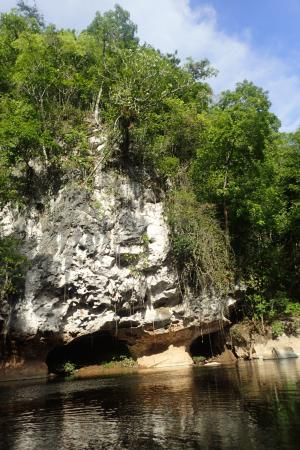 Cave Tubing & Zip Line with Explore Belize Caves: A rock formation along the river