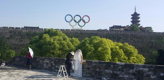 Wedding Day With Olympic Symbol And Temple In Background Picture