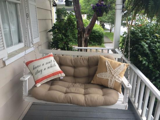 Peaceful front porch swing at the Captain's Stay
