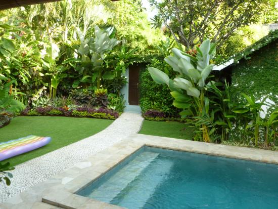 Goddess Retreats: The pool and yard within the private villa