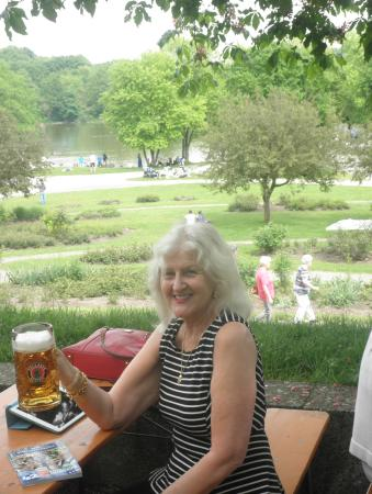 Wirtshaus am Rosengarten: A cold mug of beer at a table under a Chestnut tree, with lake and rolling green in the backgrou