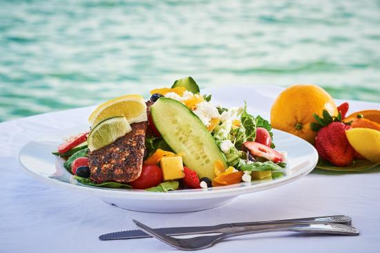 North Bay Village, FL: Tropical Salad topped with Blackened grouper