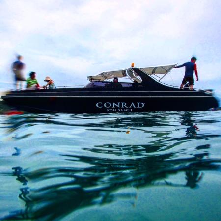 Conrad Koh Samui: Use of this boat is free to snorkel and a private island beach