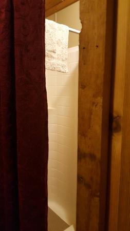 Prospectors RV Resort Bunkhouse Cabin 7 Shower and curtain door