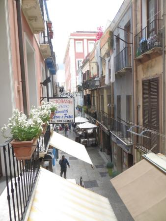 Arcobaleno Rooms: overlooking the narrow street one level down from our balcony