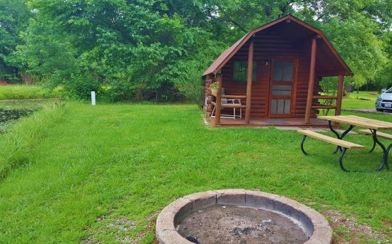 Sallisaw, OK: Cabin #1 firepit and picnic table next to the pond
