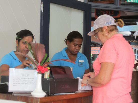 Vanua Levu, Fiji: Paying the bill with staff from the Copra Shed