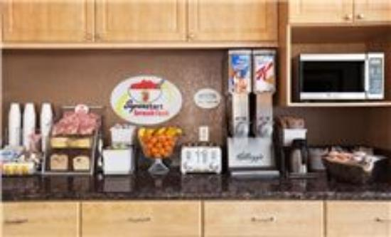 Indio Super 8 and Suites : New Breakfast set up for 8 point Super 8 Continental Breakfast.