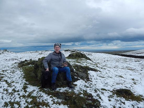 "Kirksanton, UK: Me (John) on ""Giant's throne"" with dog ""Sadie."""