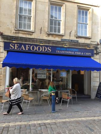 Seafoods Traditional Fish & Chips: Front of restaurant. Eat in or out and right by park.