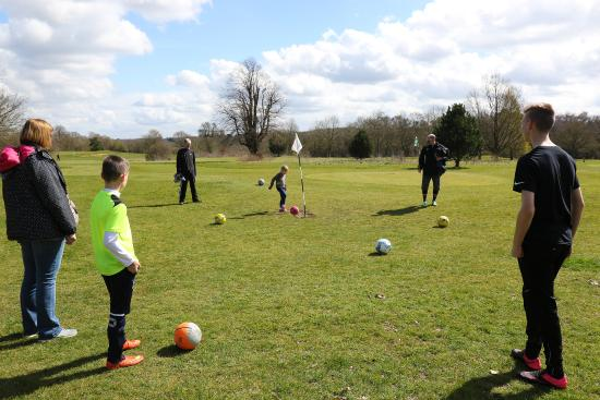 Bovingdon, UK: Family playing FootGolf