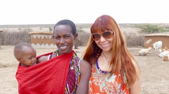 Mara Plains Camp: Masai mother with baby and I! Amazing experience!