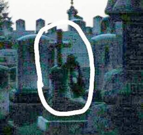 Charles Town Ghost Tours: Our migrating ghost - he shows up in both a cemetery and graveyard...In this photo he holds two