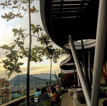 Parmessano Restaurante: Photo taken from my table at Parmessano Santafe's alfresco dining room. Perfect view of Medellín