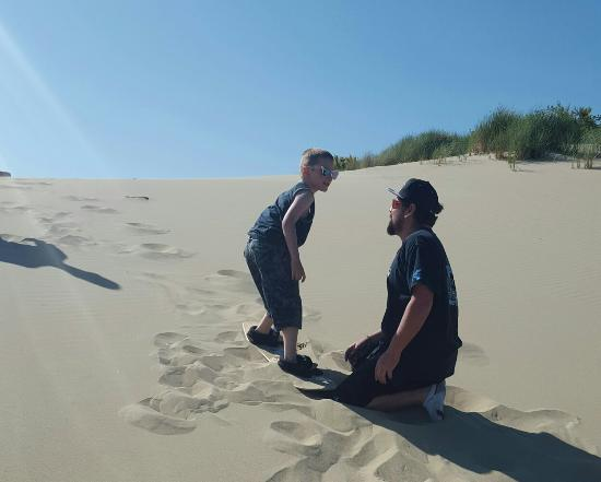 Florence, OR: Great time at sand master...Gabe teaching my boy how to sandboard!!!