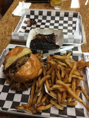 Official BBQ & Burgers: Beef brisket, pulled pork and fries were excellent, great taste, quality and quantity. BBQ sauce