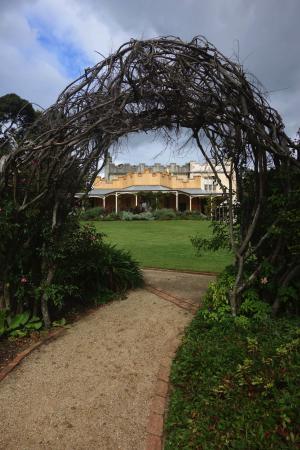 The Facade of historic Vaucluse House through a garden archway. Bring your camera!