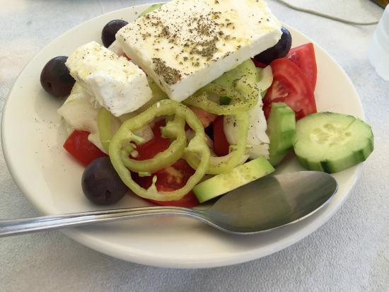 Asterias Restaurant: Tzanziki, Xoriatiki salad, and Domato temistes