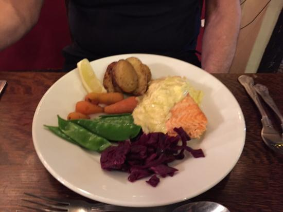 Thornham Magna, UK: Baked salmon with celeriac and tarragon sauce with baked potatoes and mixed vegetables. Amazing