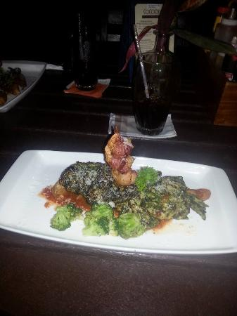 Chicken, on Roasted potatoes with marnara sauce and topped with pesto and shrimp wrapped in baco