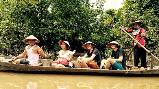 Royal Saigon Guesthouse: With guests on Mekong Delta