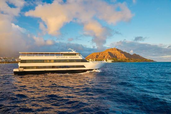 Bask in beautiful Waikiki and Diamond Head views during sunset on Atlantis Cruises!