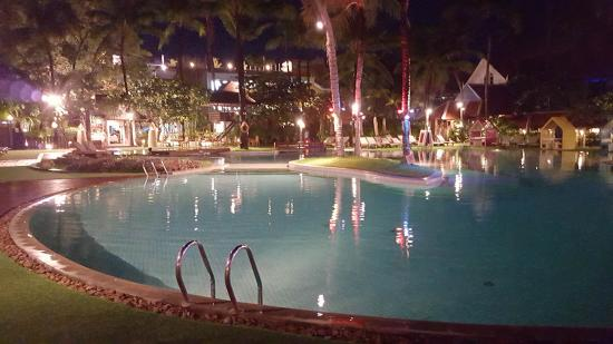 Patong Beach Hotel: part of the pool at night