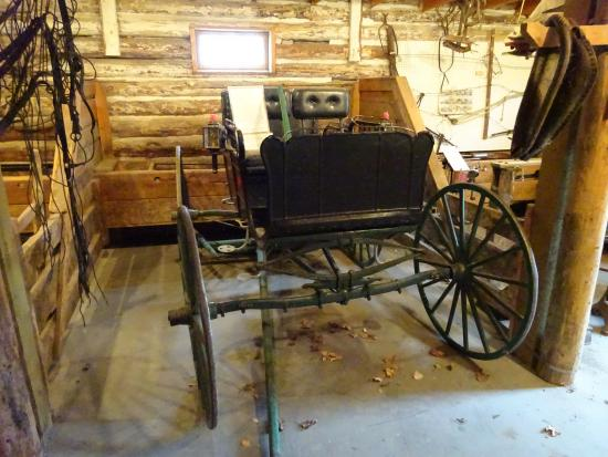 Kootenai Brown Pioneer Village: Old carriage in the garage