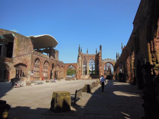 Coventry, UK: Long view of the old cathedral, bombed out in 1940, with the portico of the new above the left s