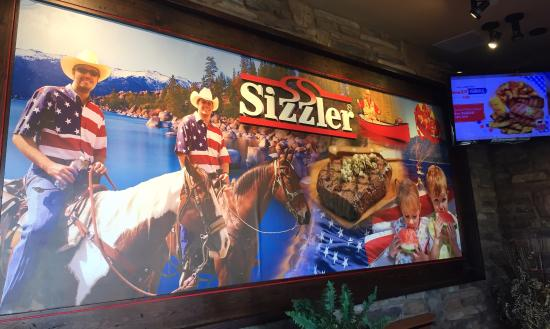 Sizzler: Stunning photo at the entrance, depicting an All American Steak House setting.