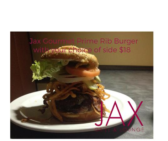 Jax Grill & Lounge : Prime Rib Burger with Blue Cheese, fried onions, bacon, tomato and a fried egg