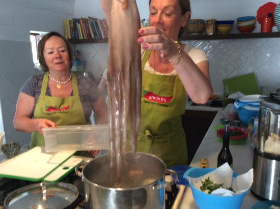 Annie B's Spanish Kitchen : Sarah preparing a large octopus.