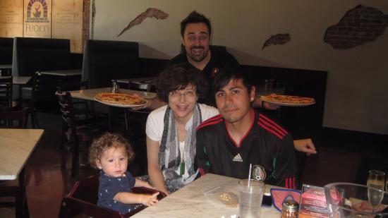 Fuoco Pizzeria Napoletana: with my former student and his son. tullio behind us.