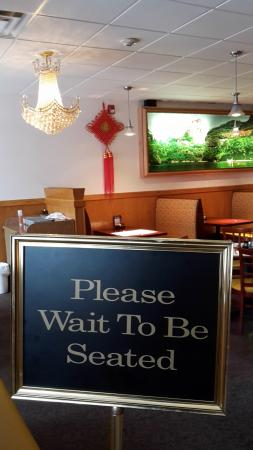 Littleton, NH: wait to be seated-sign and 'living painting'