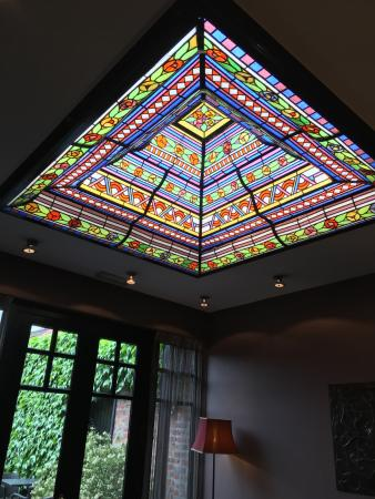 Main Street Hotel: They found this beautiful glass ceiling window in a shop and replaced the original one by this o