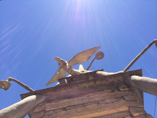 Lucas, KS: guardian angel peers down from the top of the mausoleum